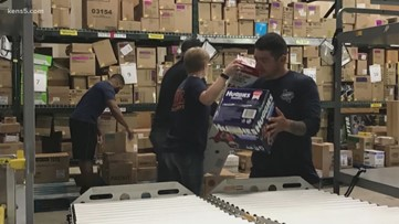 Firefighters and police officers volunteer their time to keep shelves stocked in Seguin