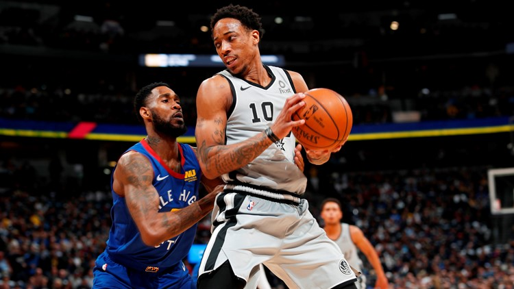 BKN Spurs guard DeMar DeRozan looks to make a move against Nuggets in the first half of Game 1 against Denver
