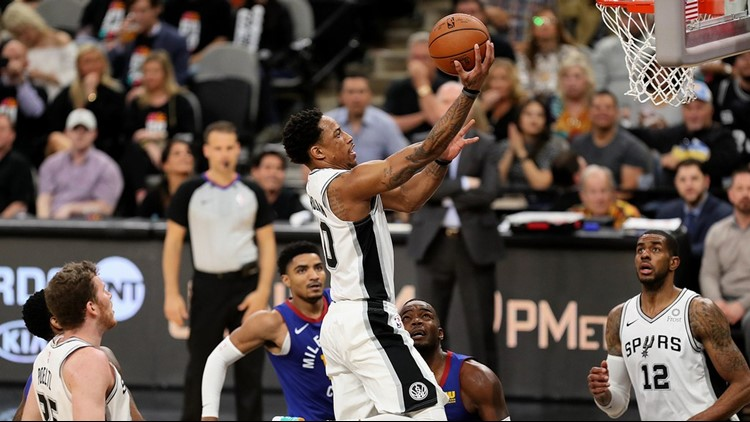 BKN Spurs guard DeMar DeRozan goes up for a layup against the Nuggets in Game 3