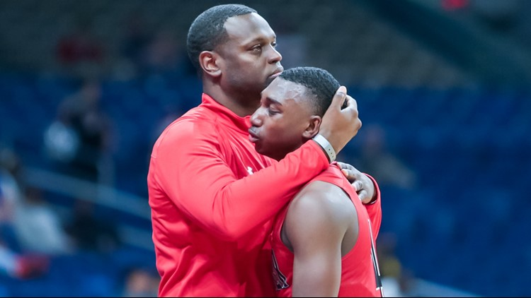 Wagner coach Rodney Clark comforts four-year starting point guard Jalen Jackson