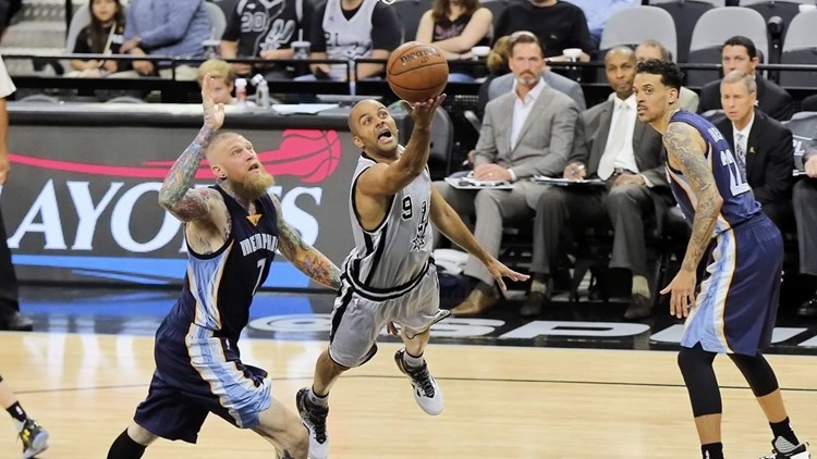 Spurs point guard Tony Parker drives to the basket against the Grizzlies