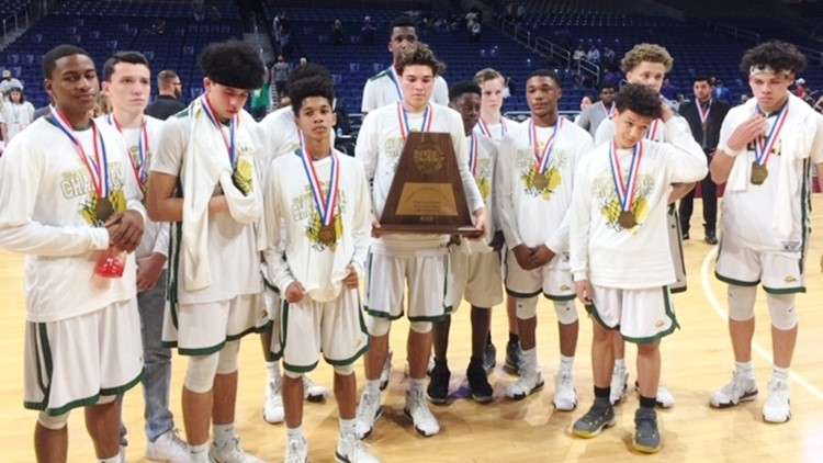 Cole players with their state-qualifer trophy after losing to Dallas Madison in semifinal