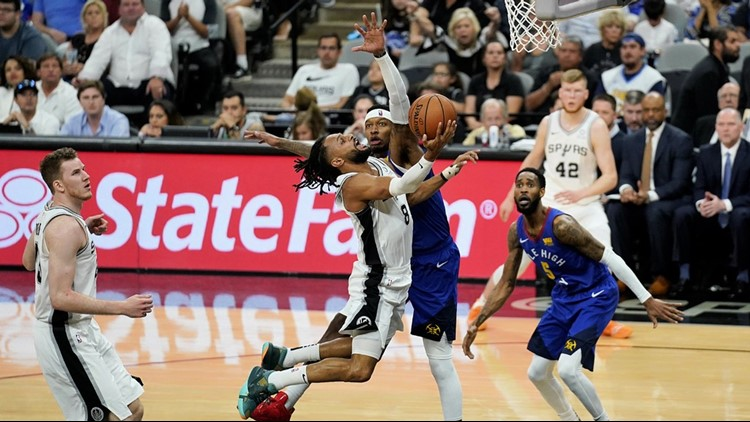 BKN Spurs guard Patty Mills goes up for a shot against the Nuggets in Game 4