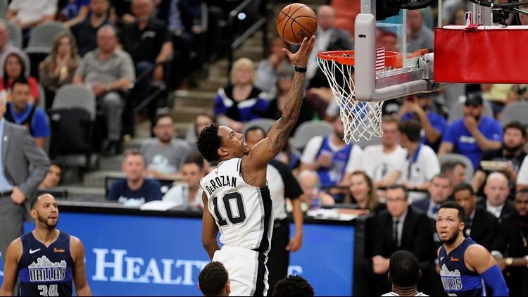 BKN Spurs guard DeMar DeRozan scores on a layup against the Mavs