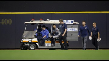 Astros' George Springer carted off field after he collides with wall