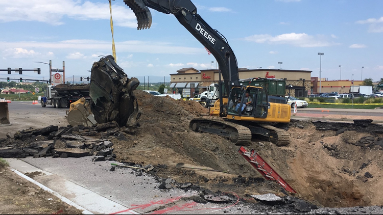 Crews remove SUV from 'massive' Sheridan sinkhole