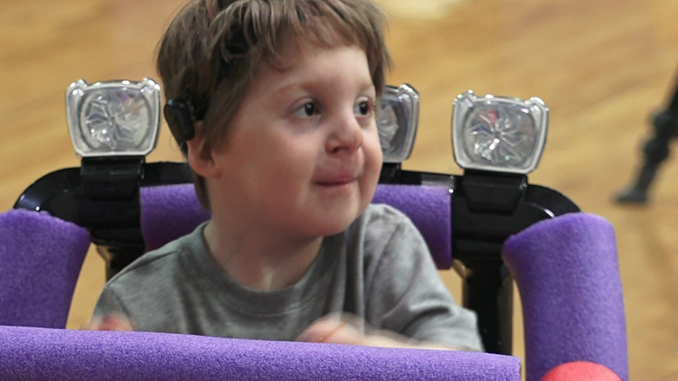 Austin high school students helping children with disabilities have fun, one car at a time