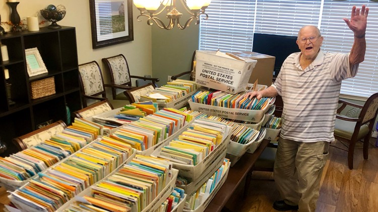 James South next to hundreds of his birthday cards