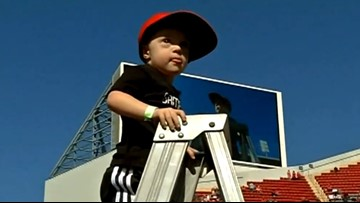 4-year-old with down syndrome leads band during halftime show of Louisville football game